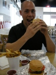 Jamie enjoying hi Five Guys Burger and Fries meal