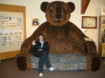 Jen on the giant bear couch at the Bear & Wolf Discovery Centre