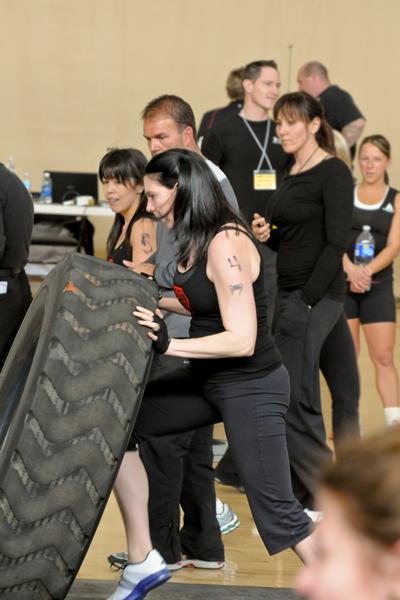 Jen flipping the 250lb tire