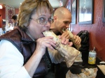 Donna and Jamie take the first bite into beef pita goodness
