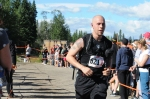 """Hubby comes into the finish chute! Only to wait another couple minutes to officially """"clock in"""""""