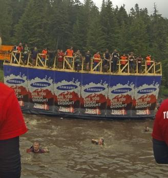 Jen jumps off the 15' Walk the Plank. Glenn swims ashore.