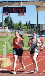 Jen & Paula crossing the finish line @ the Stampede Road Race